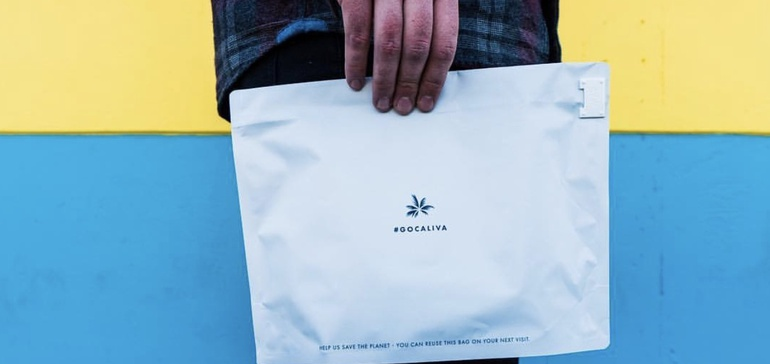 Person holding package with Caliva cannabis logo