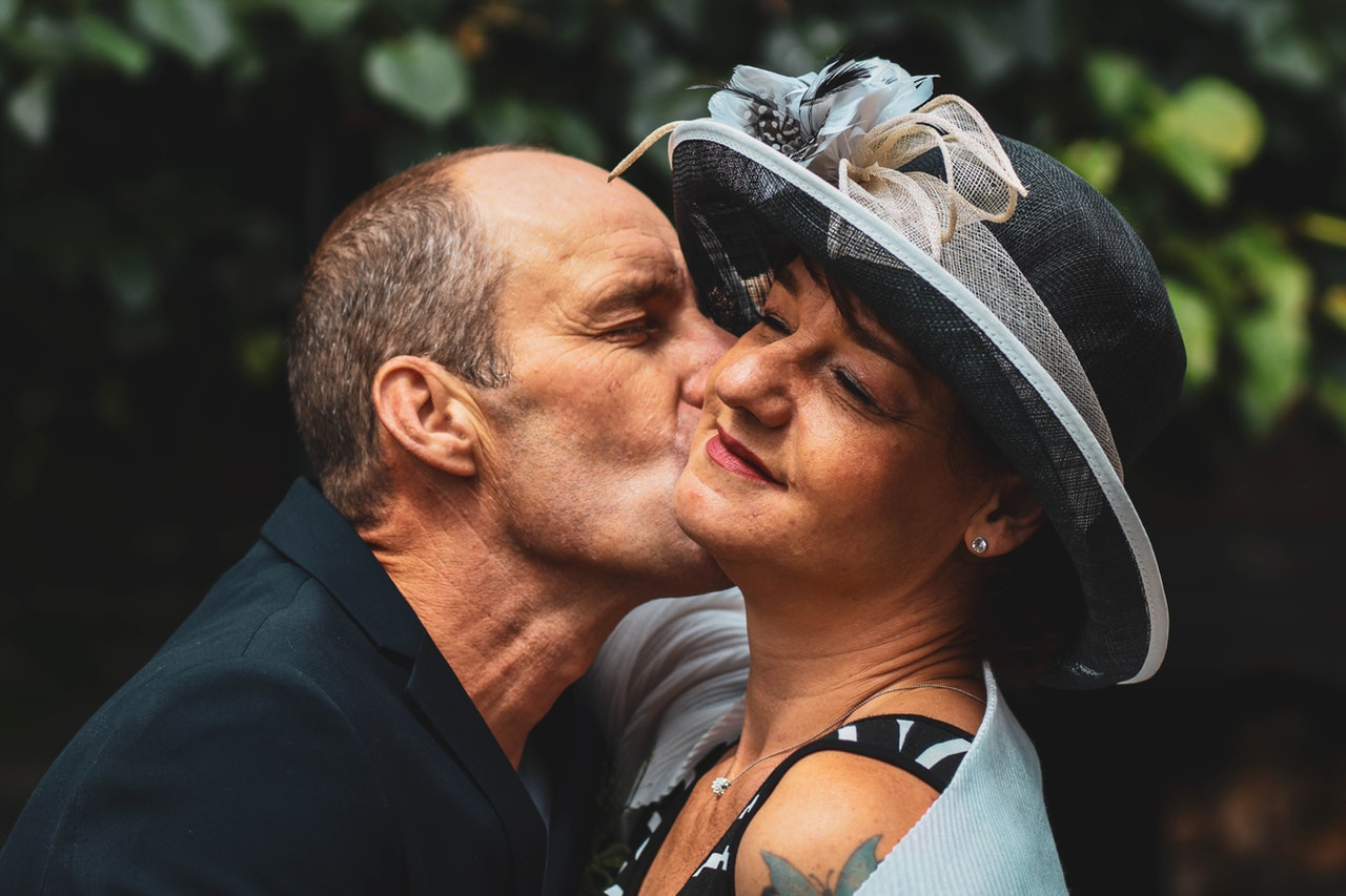 guy kissing wife