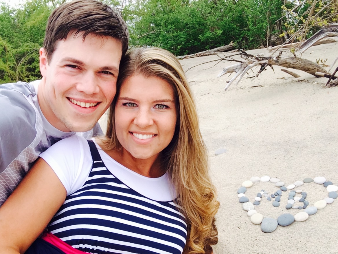 michaela bates and husband brandon pose together on the beach