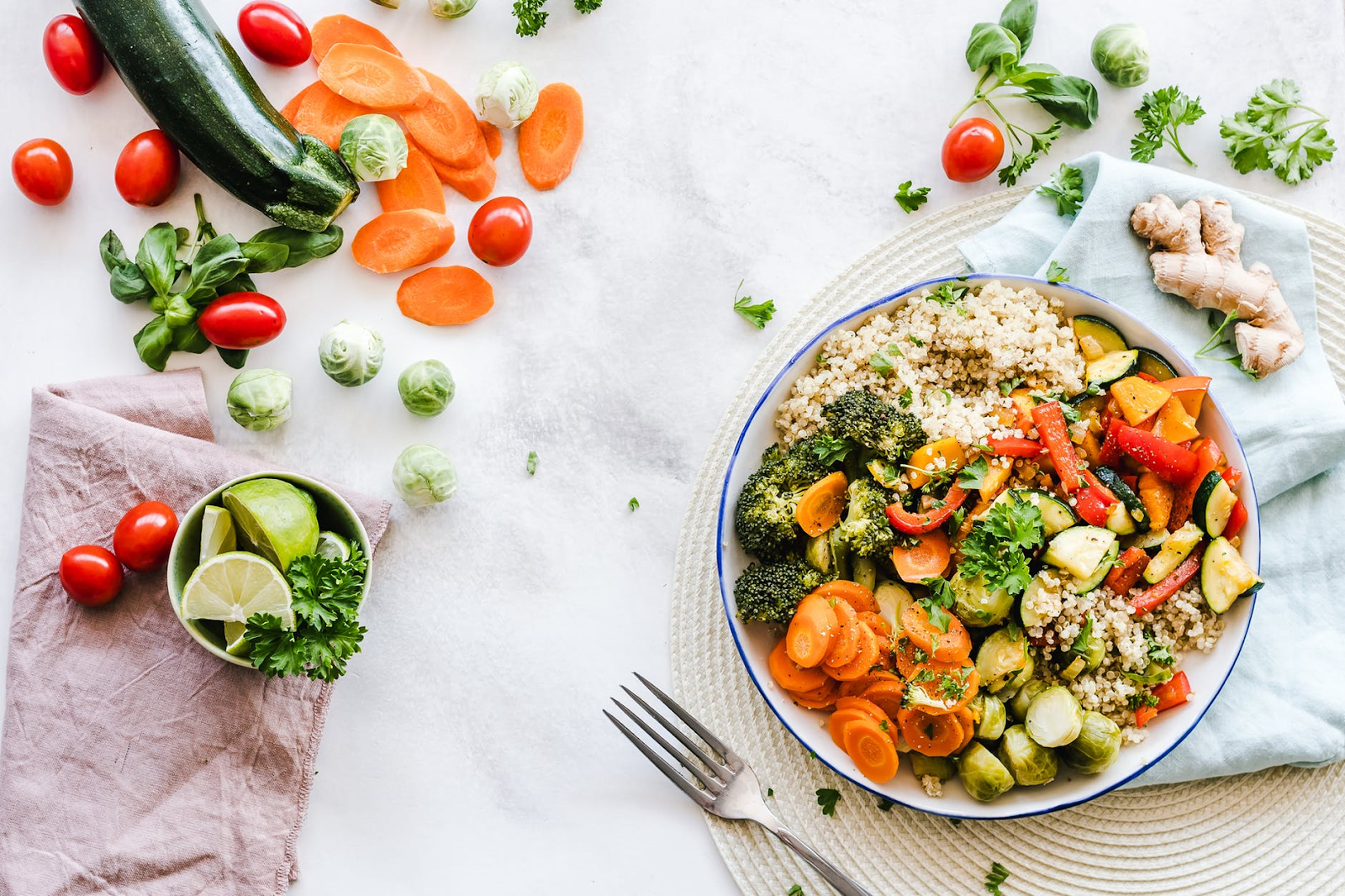 healthy food on a plate accompanied by fresh vegetables