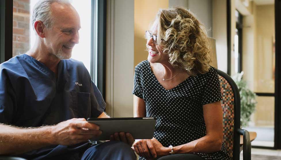Photo of Upper Arlington dentist Jody Kear and a patient looking at an iPad