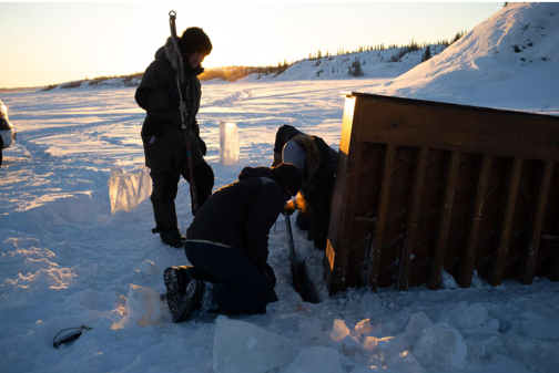 Placing piano in ice on Great Slave lake.