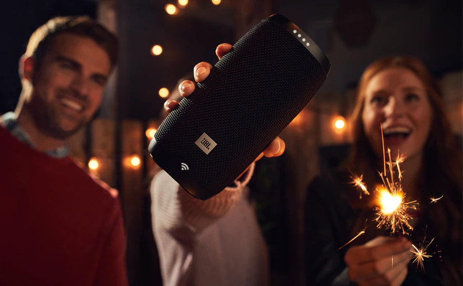 people laughing with JBL Portable Speaker