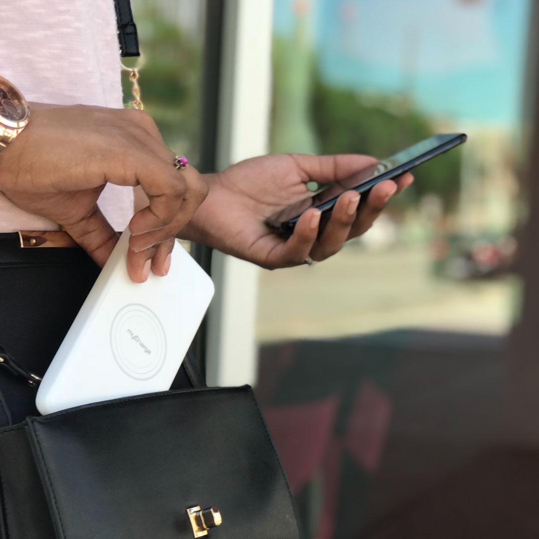 man holding phone and myC