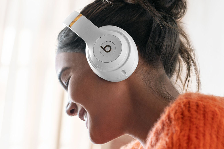 women using beat studio3 wireless headphones