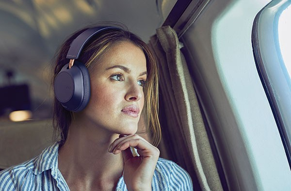 Plantronics headphones woman wearing on a plane