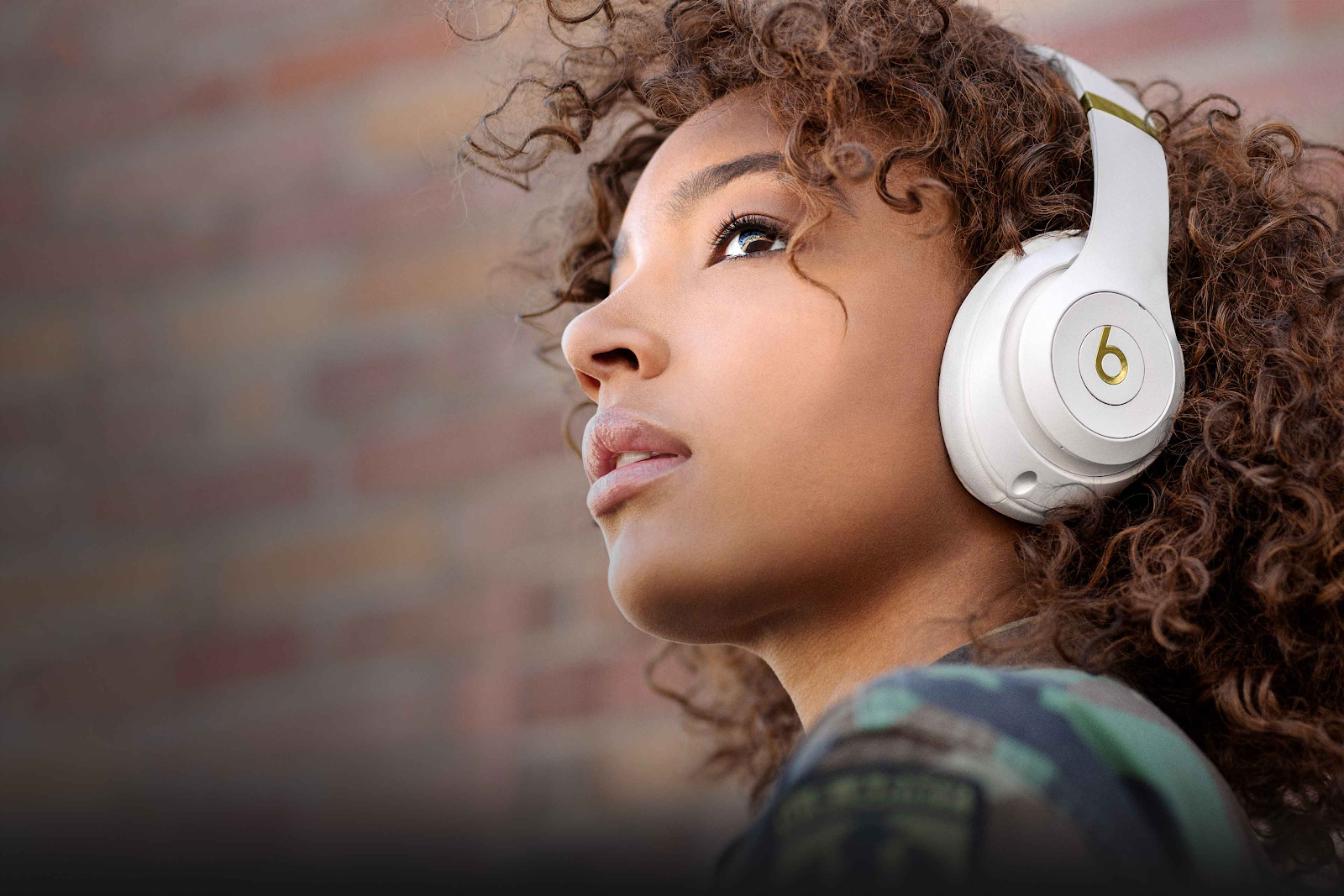 Beats by Dre Studio 3 white woman looking up