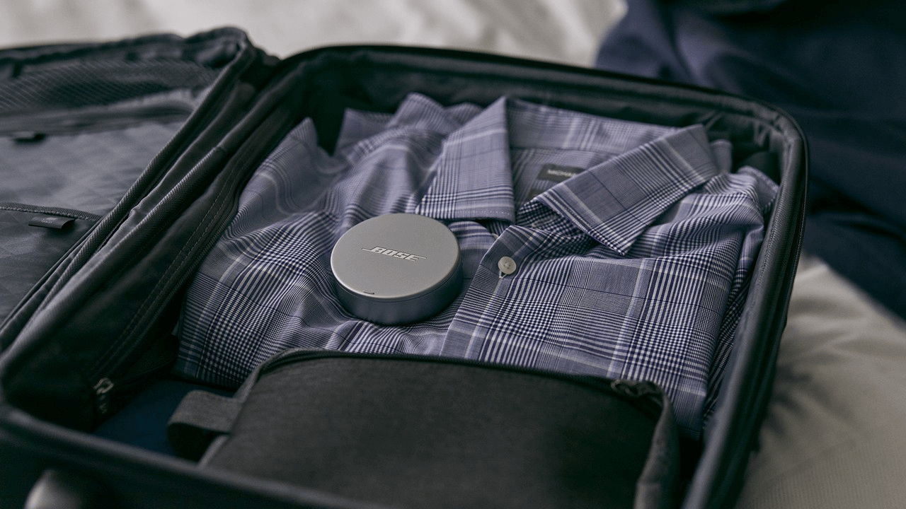 Bose sleepbuds case packed inside of a suitcase