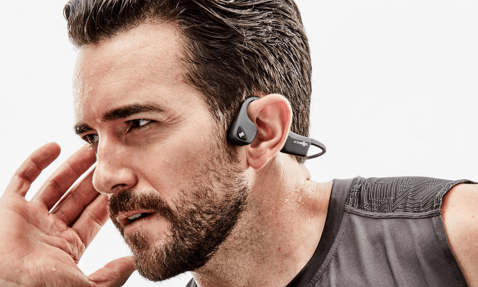 man wearing bluetooth headphones