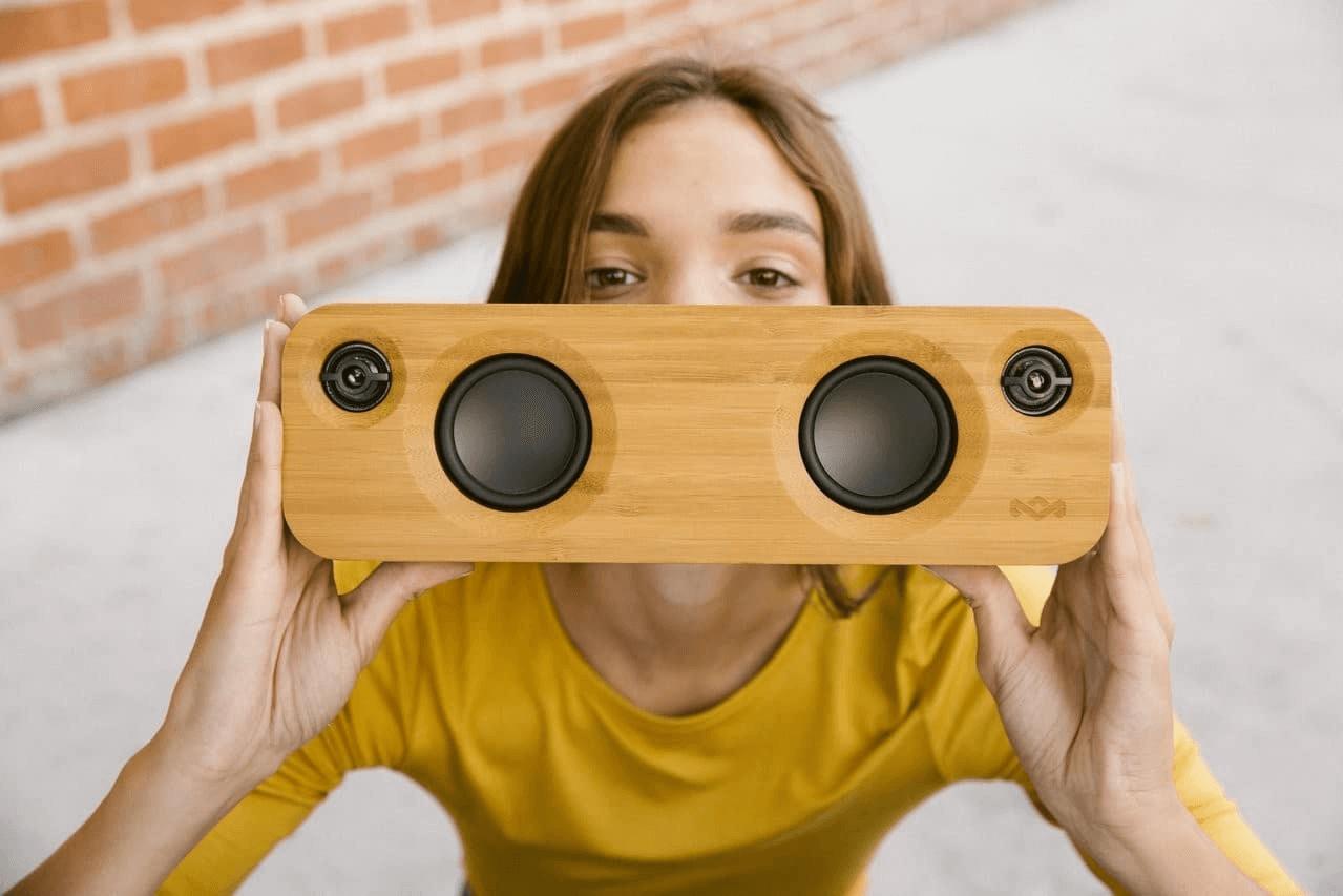 girl holding speaker / beach jams macine