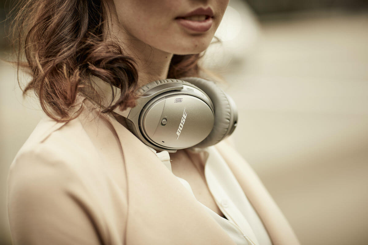 Girl with Bose Wireless Headphones around her neck