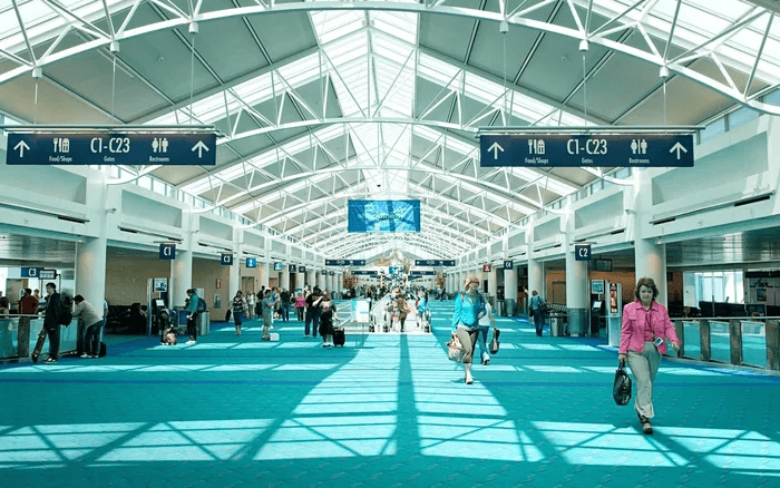 people walking through airport interior