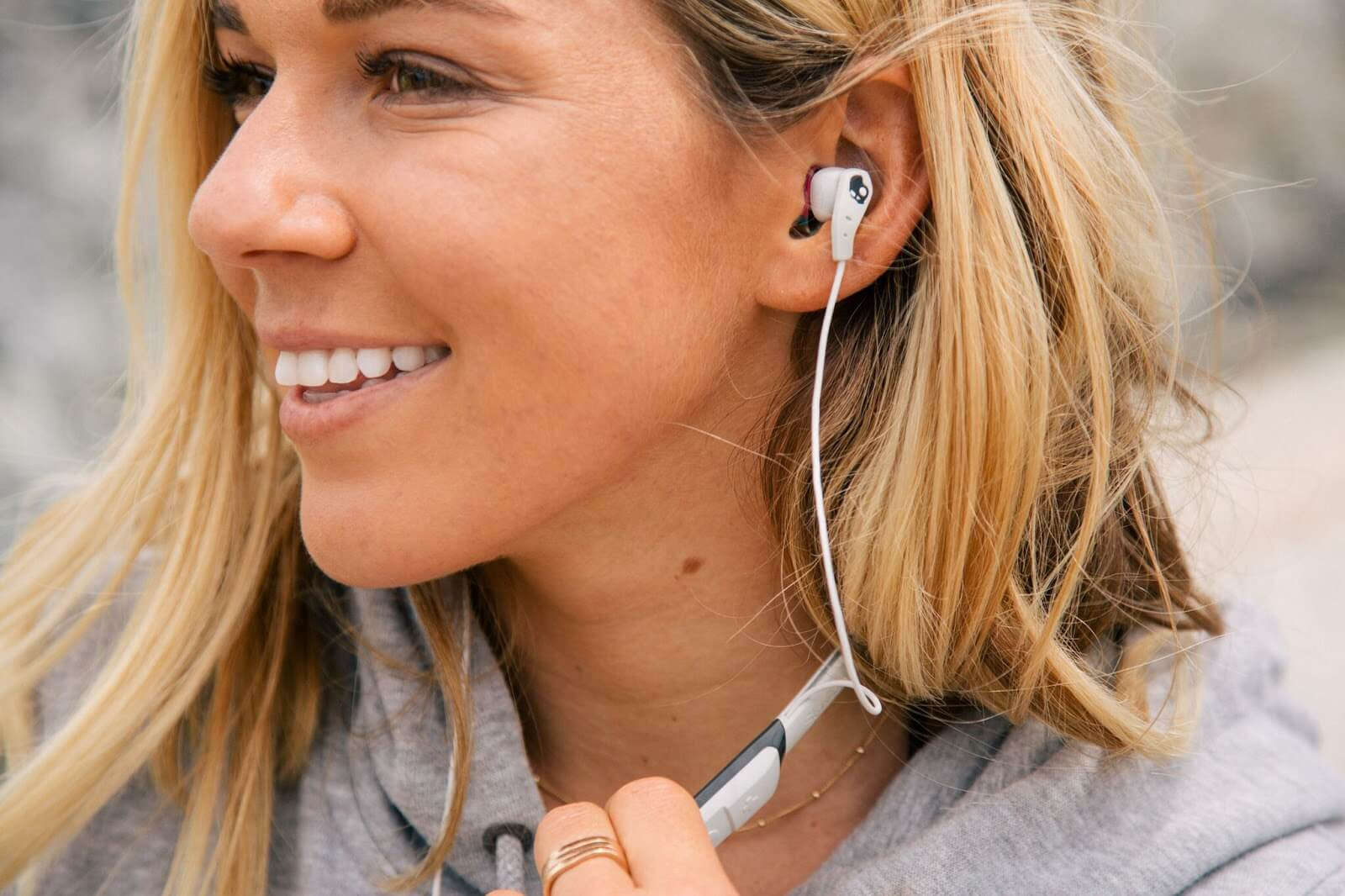 woman wearing Method Bluetooth Wireless Sport Earbuds