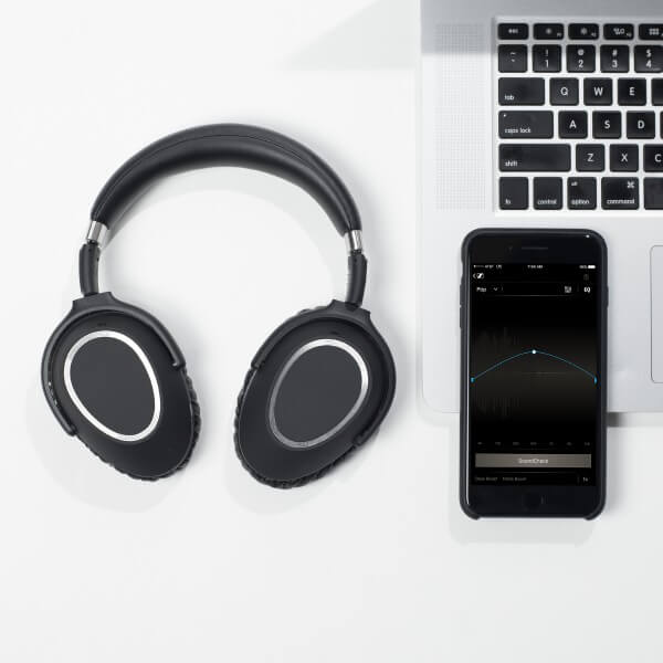 Sennheiser PXC 550 Wireless Bluetooth Headphones next to an iphone