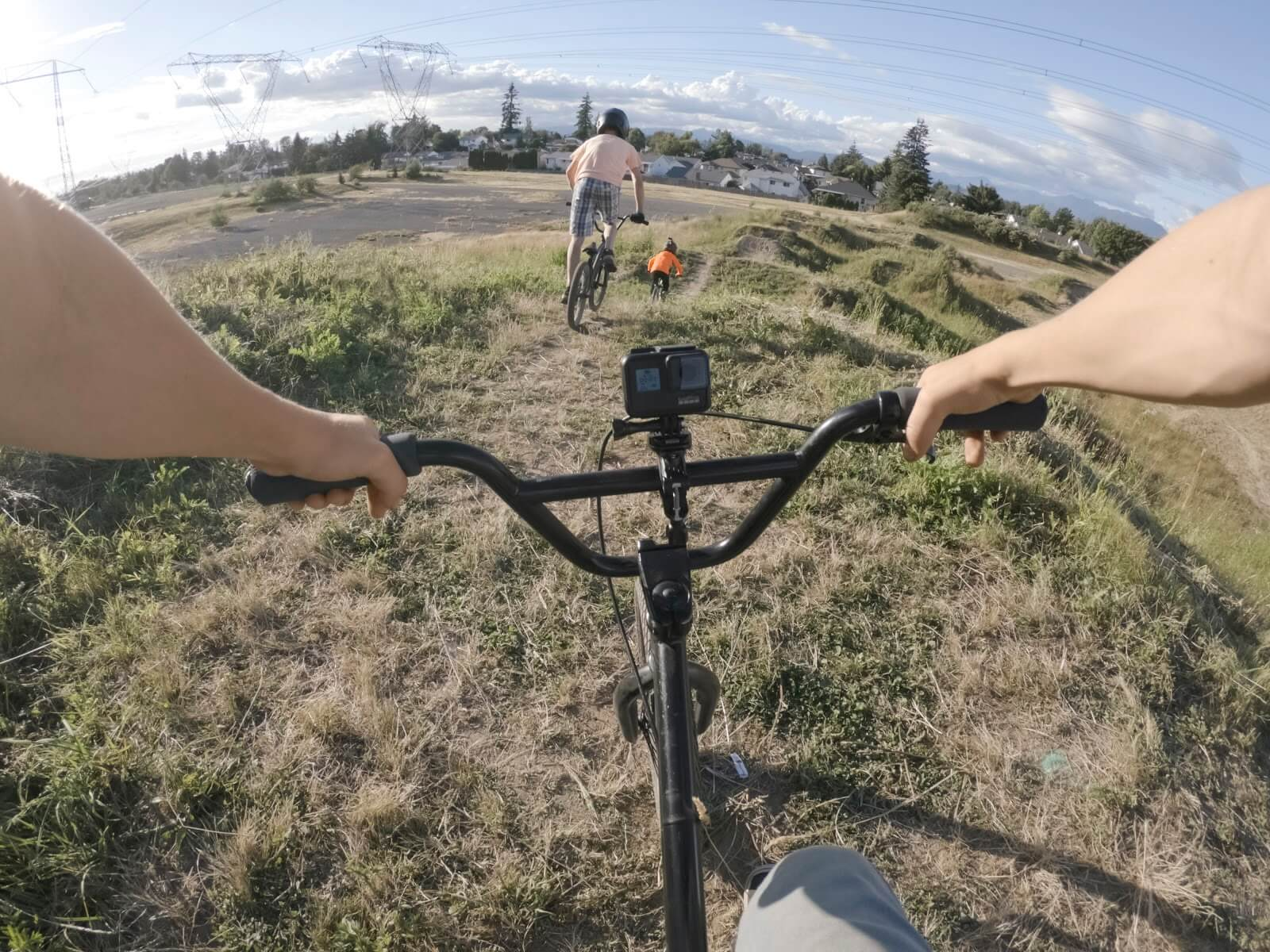 first-person perspective of a person riding a bike in grassy fields