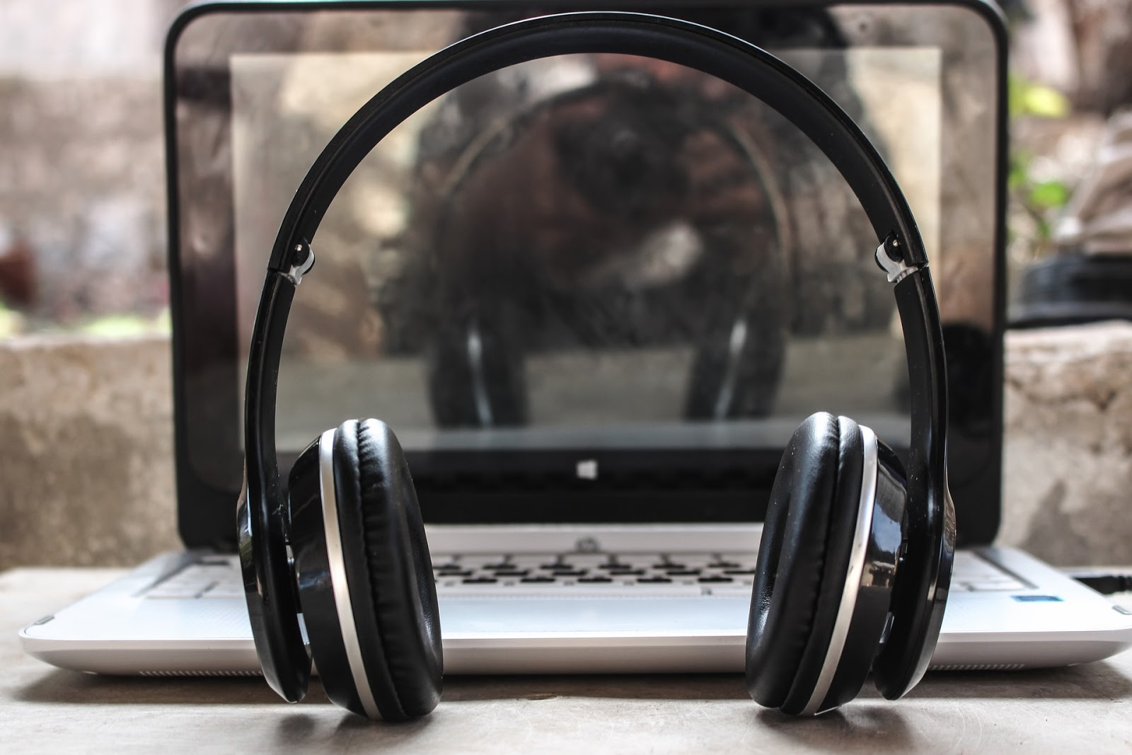 headphones placed in front of a laptop