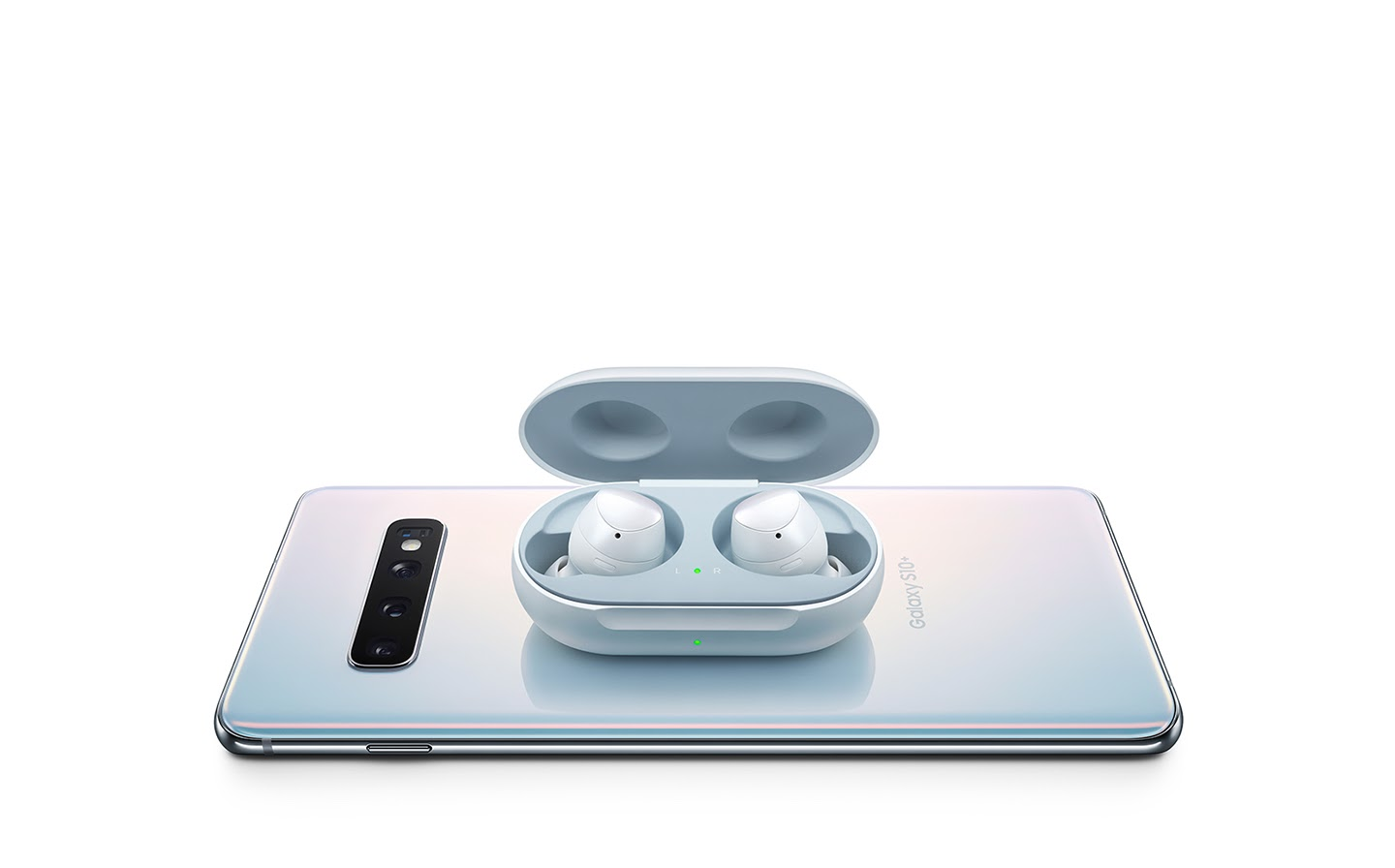 wireless earbuds on top of cell phone