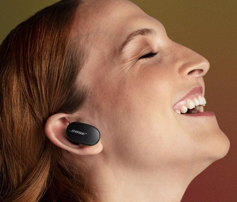 woman wearing Bose QuietComfort Earbuds