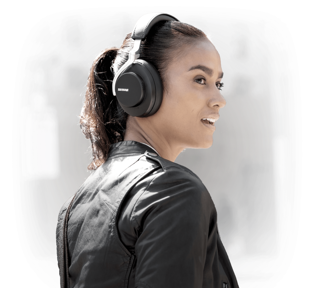 woman wearing Shure AONIC 50 Wireless Noise Cancelling Headphones