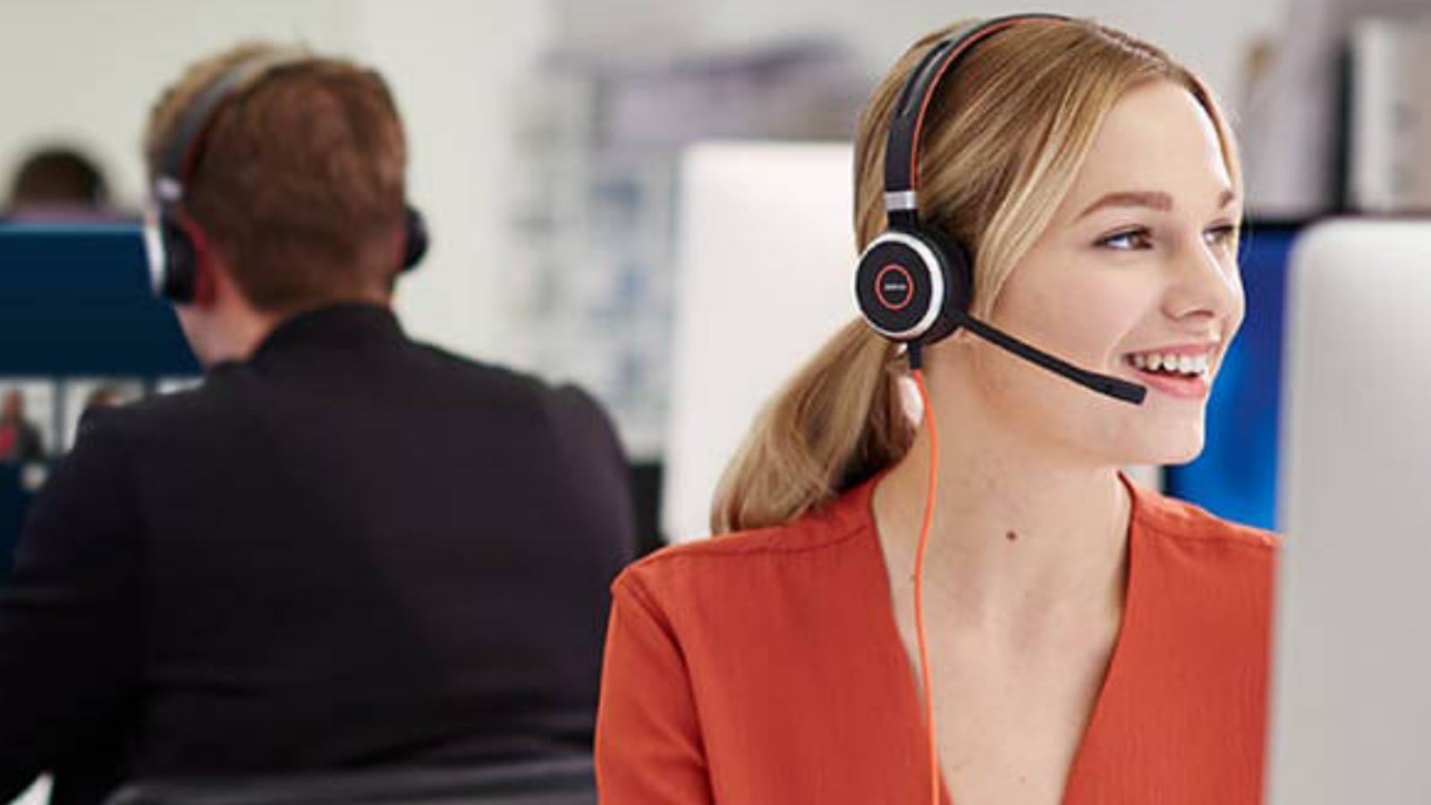 woman answering work calls with Jabra Evolve 40 headset