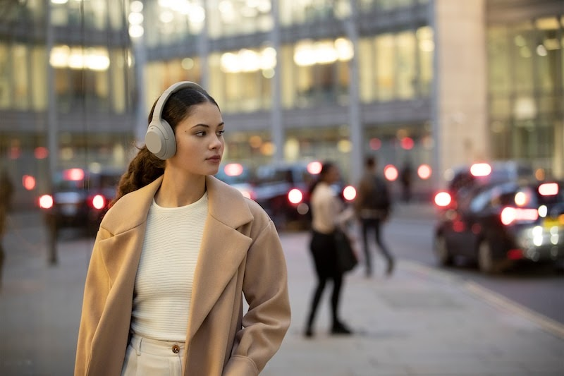 woman wearing a pair of white headphones