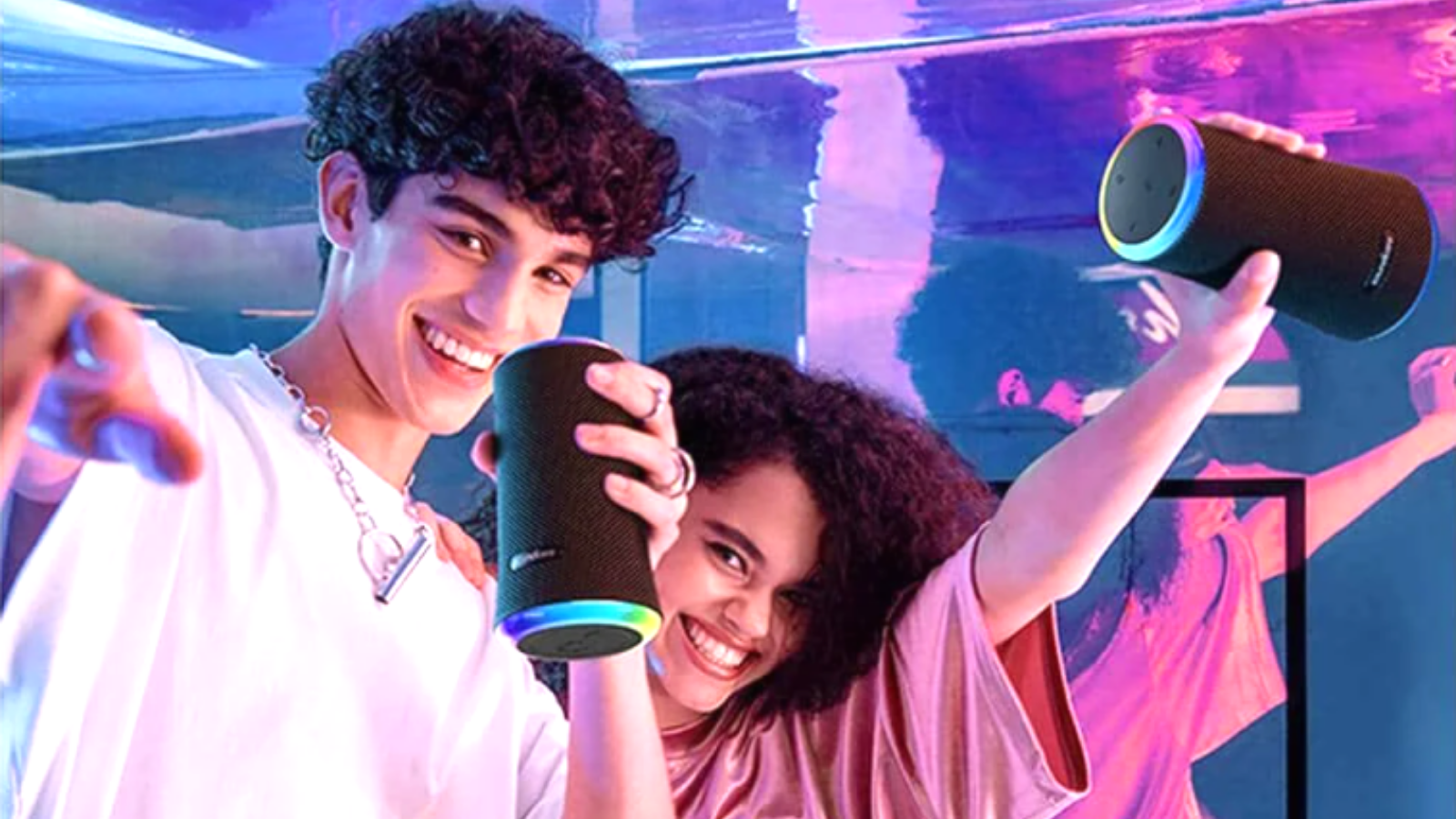 two teens partying with their Anker Soundcore Flare 2 Bluetooth Speaker
