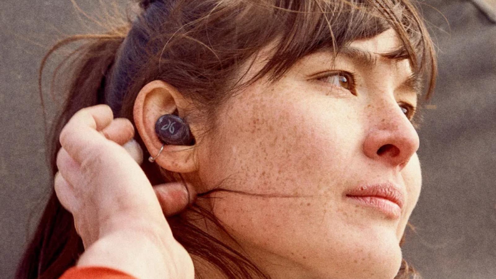 closeup of a woman wearing JayBird Vista 2 Earbuds