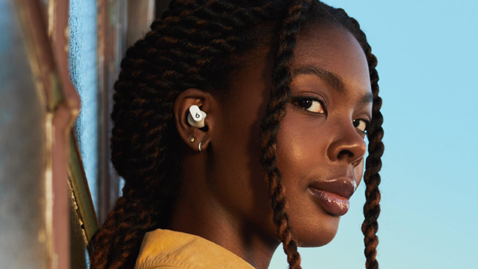 closeup of woman wearing Beats by Dre's Studio Buds