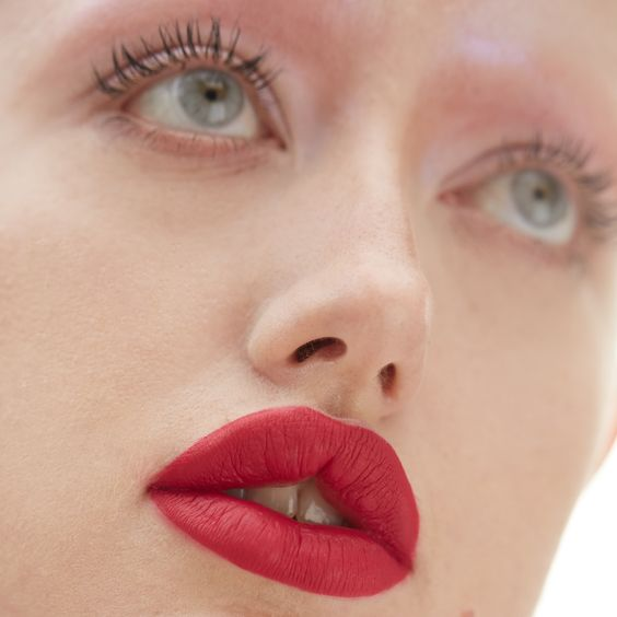 A bold red lip look with space age ultra violet eyes...