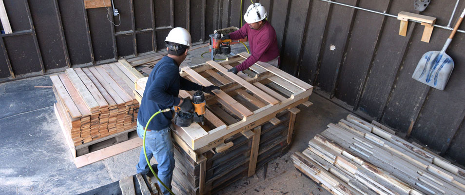 workers nailing a pallets together
