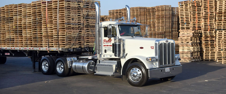 flat bed 18 wheeler with pallets on it