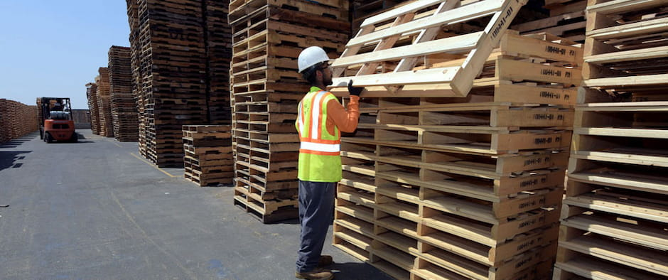 worker stacking finished pallets