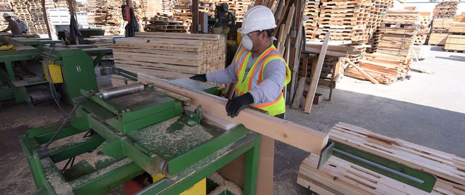 putting pallets together with nail gun