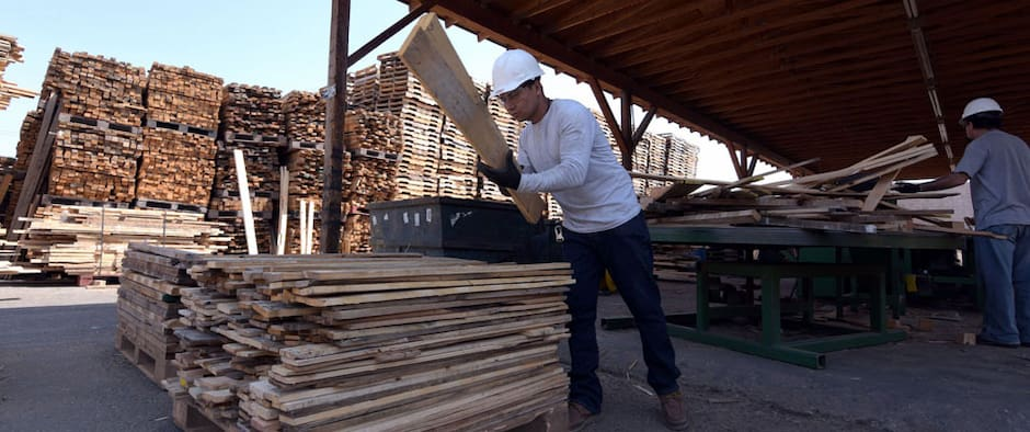 workers stacking good recycled wood