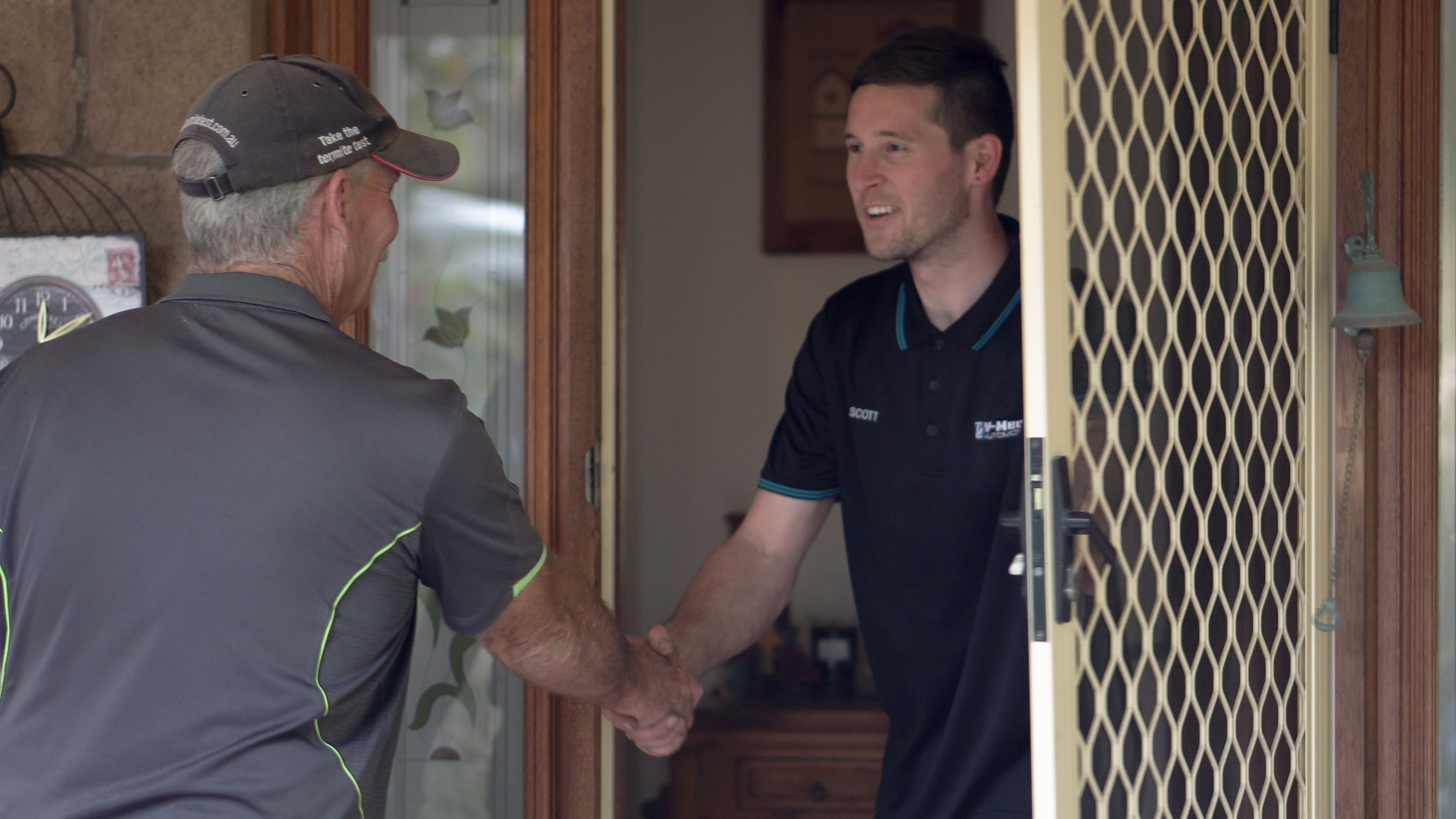Suburban Pest Control technician greets client for a pest inspection