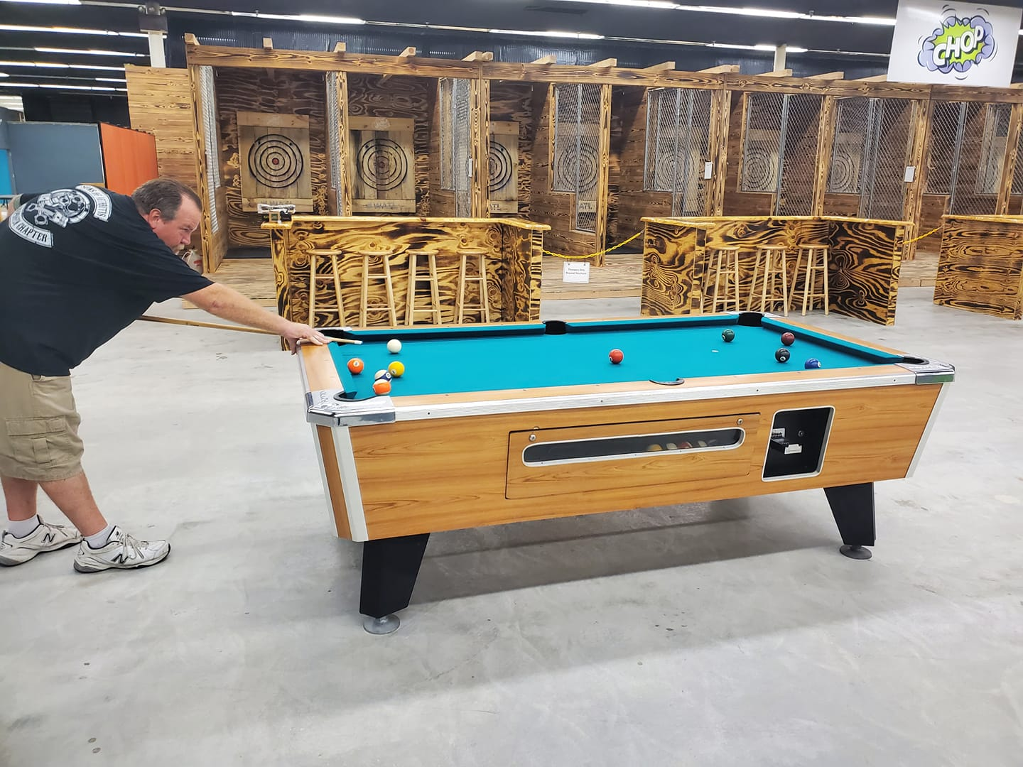 Photo of a man playing billiards