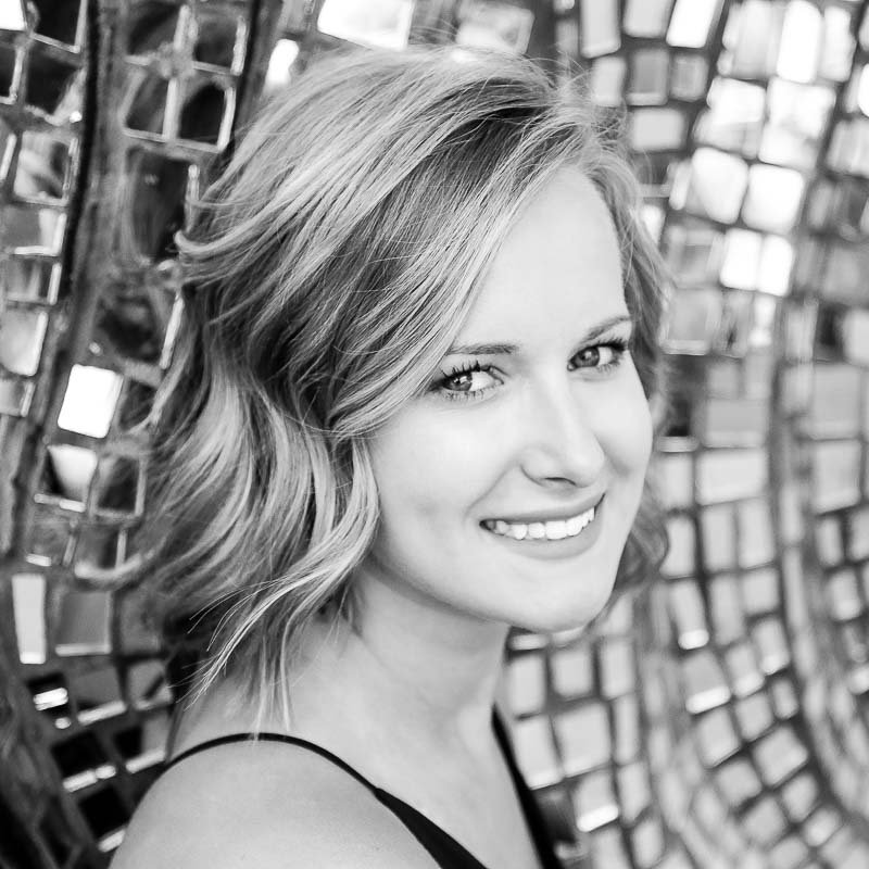Black and white photo of senior photography session with Shelby Gulpker at the Grand Rapids Children's Museum in Grand Rapids, Michigan.
