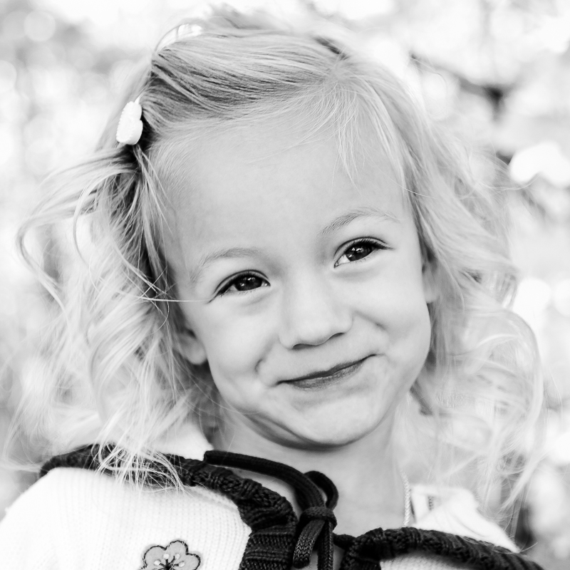 Black and white photograph of fall session of Fiona Olson, taken in Mohawk, Michigan.