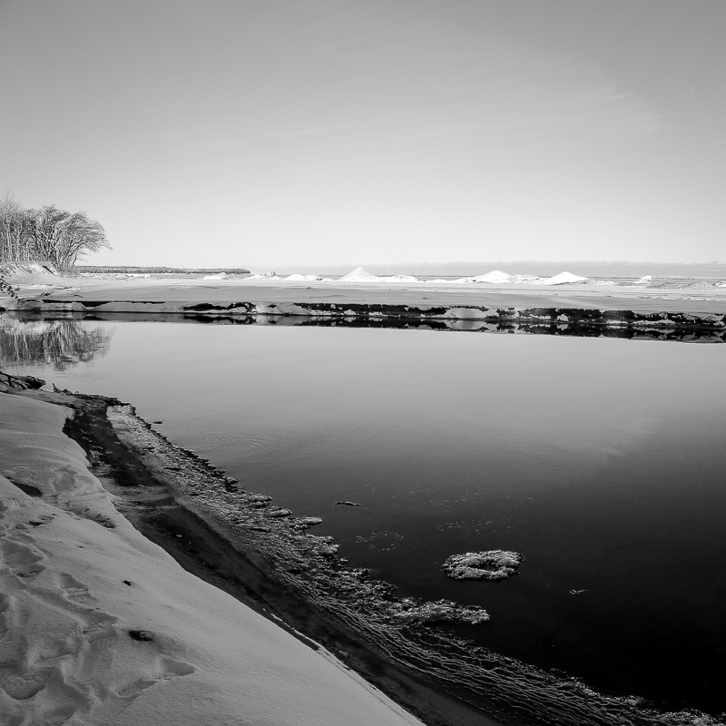 Black and white photograph of the snow and ice at Misery Bay, in Toivola, Michigan.