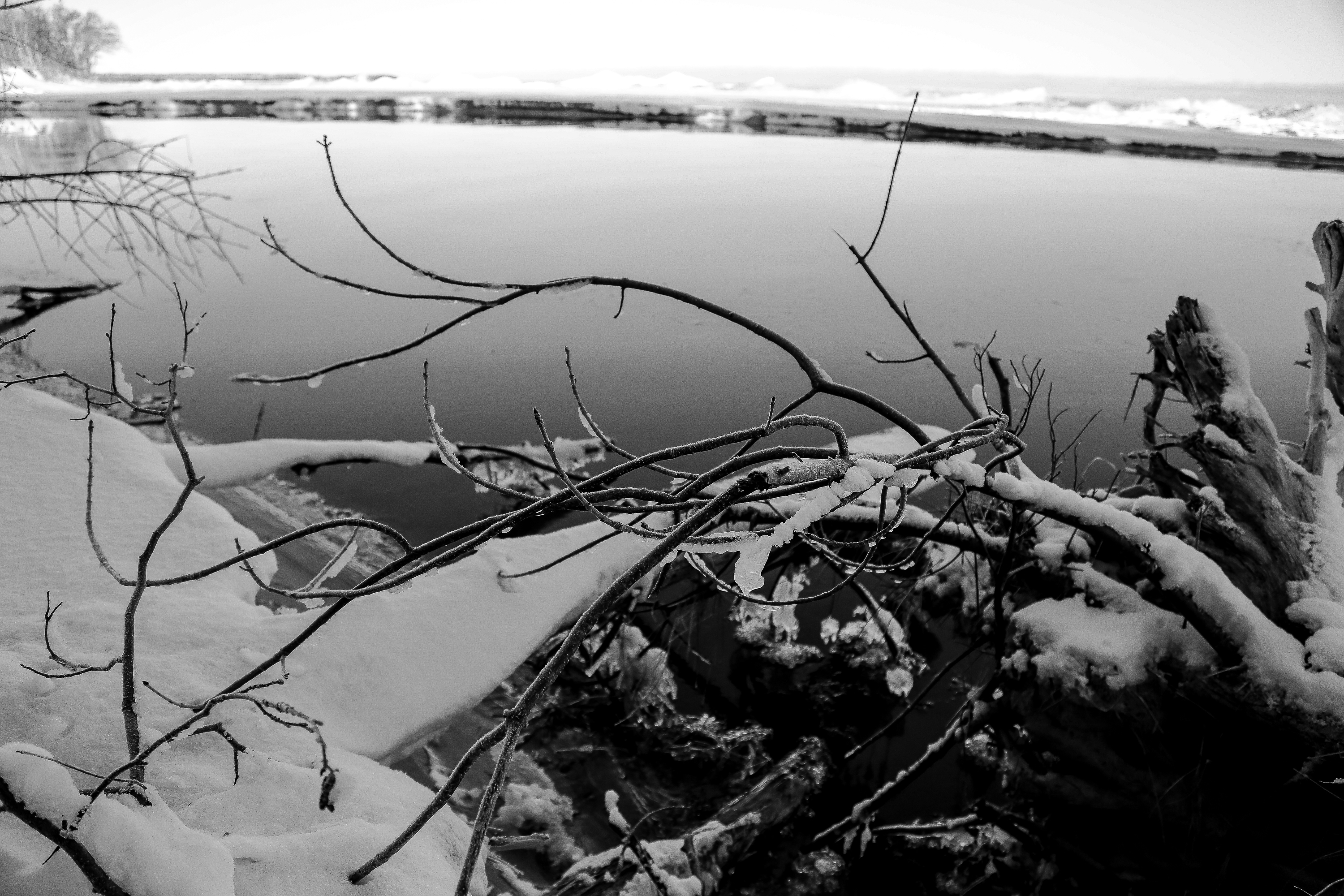 Landscape photography during the winter months of snow and ice at Misery Bay, located in Toivola, Michigan.
