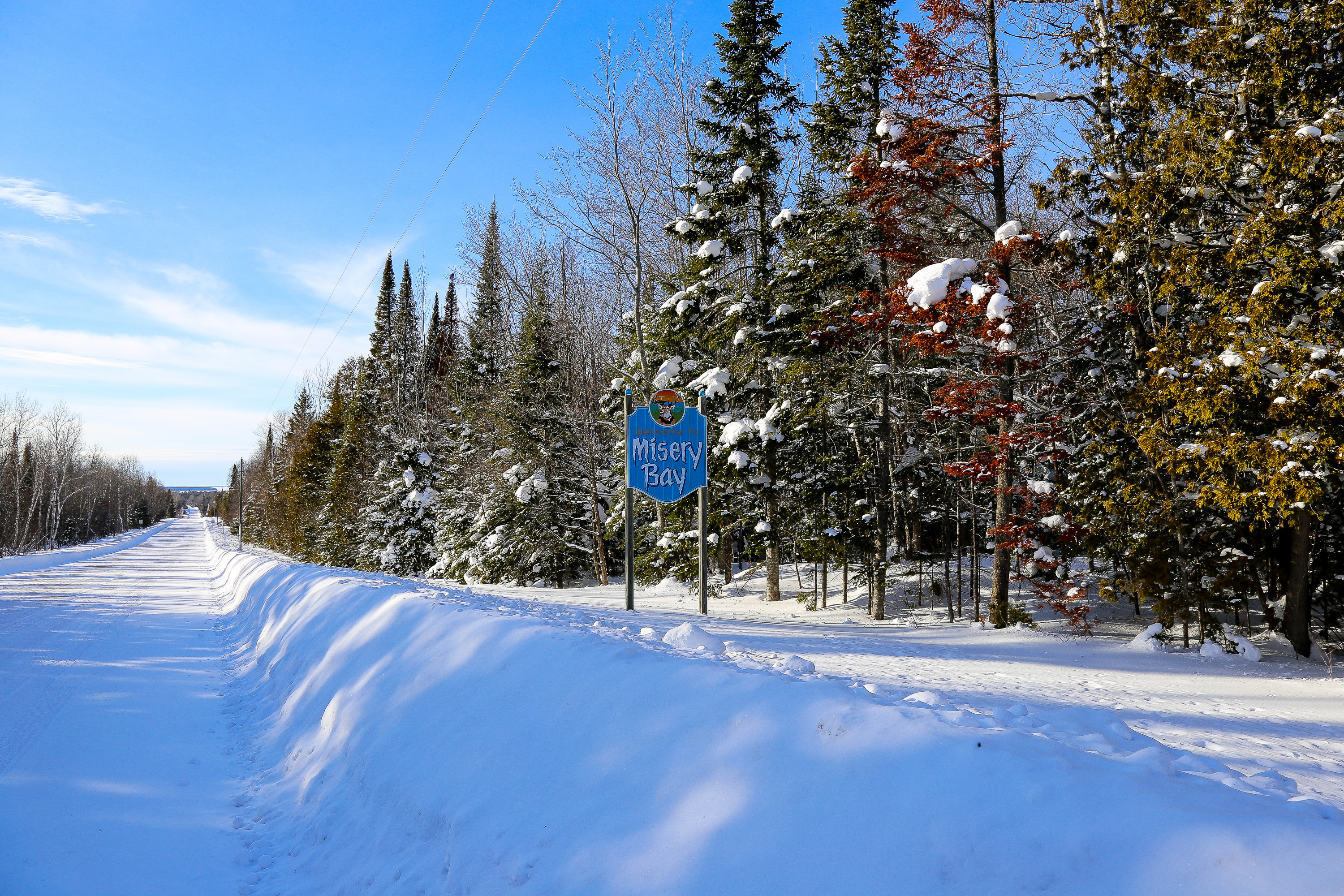 Photograph of the Agate Beach Sign in the winter, located in Toivola, Michigan.