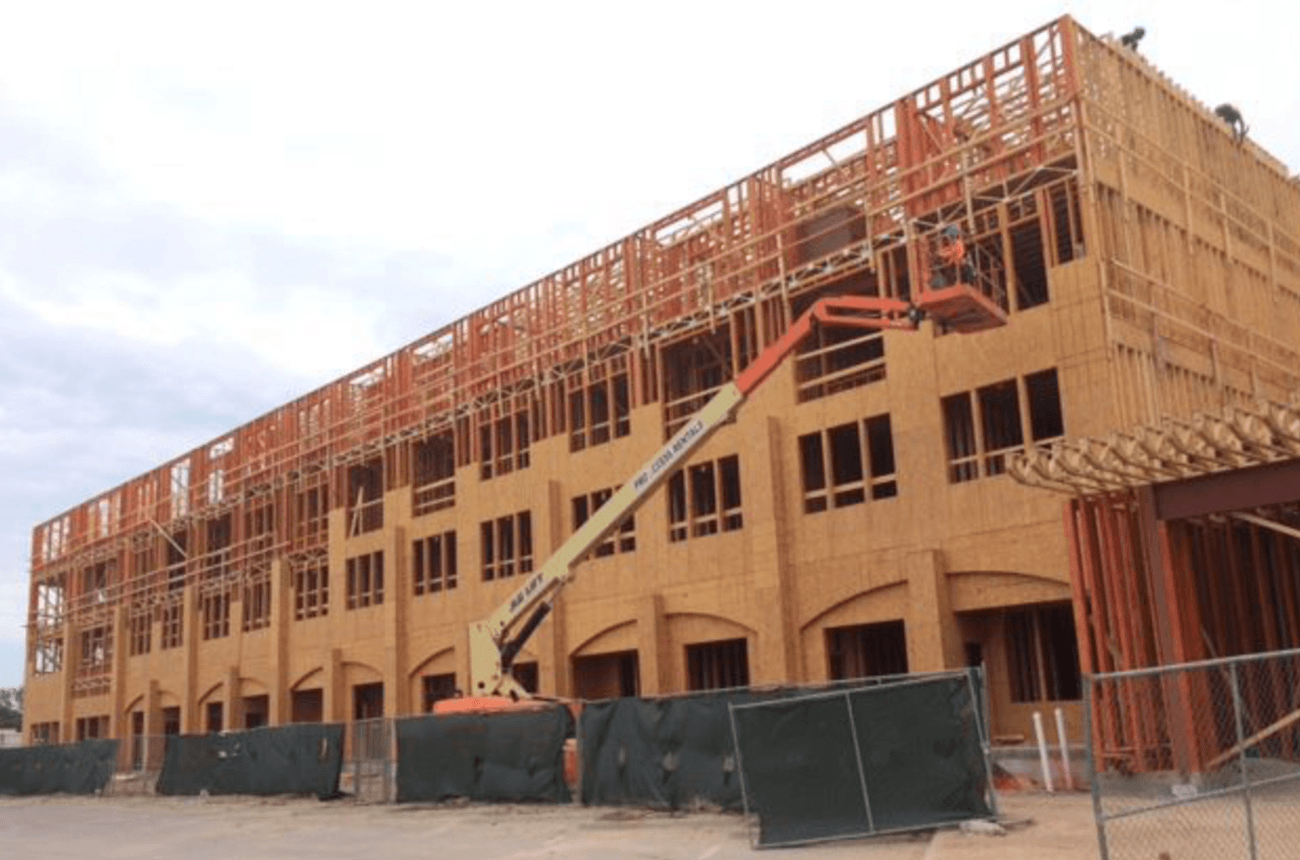 Image of upscale apartments on Main Street in Jenks. Services provided by Arrow Construction Resources