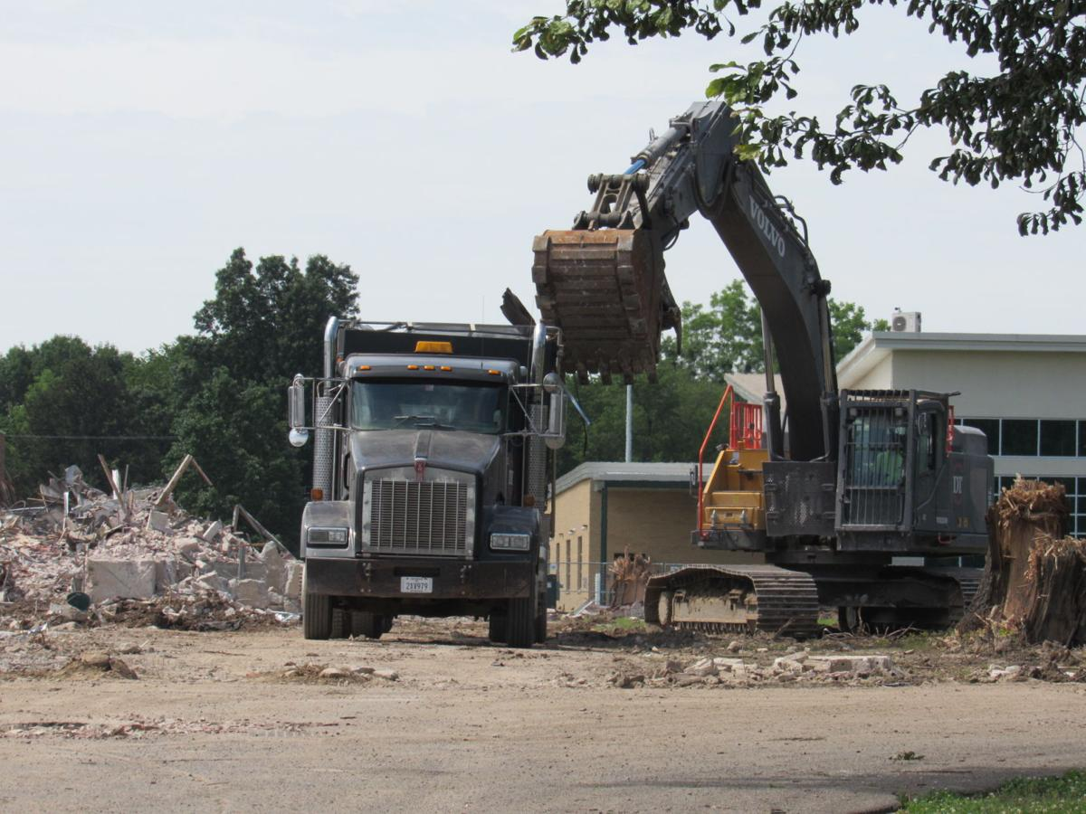 An excavator loads debris from the former Alice Robertson Junior High building. A Freshman Academy is to be built on that site.