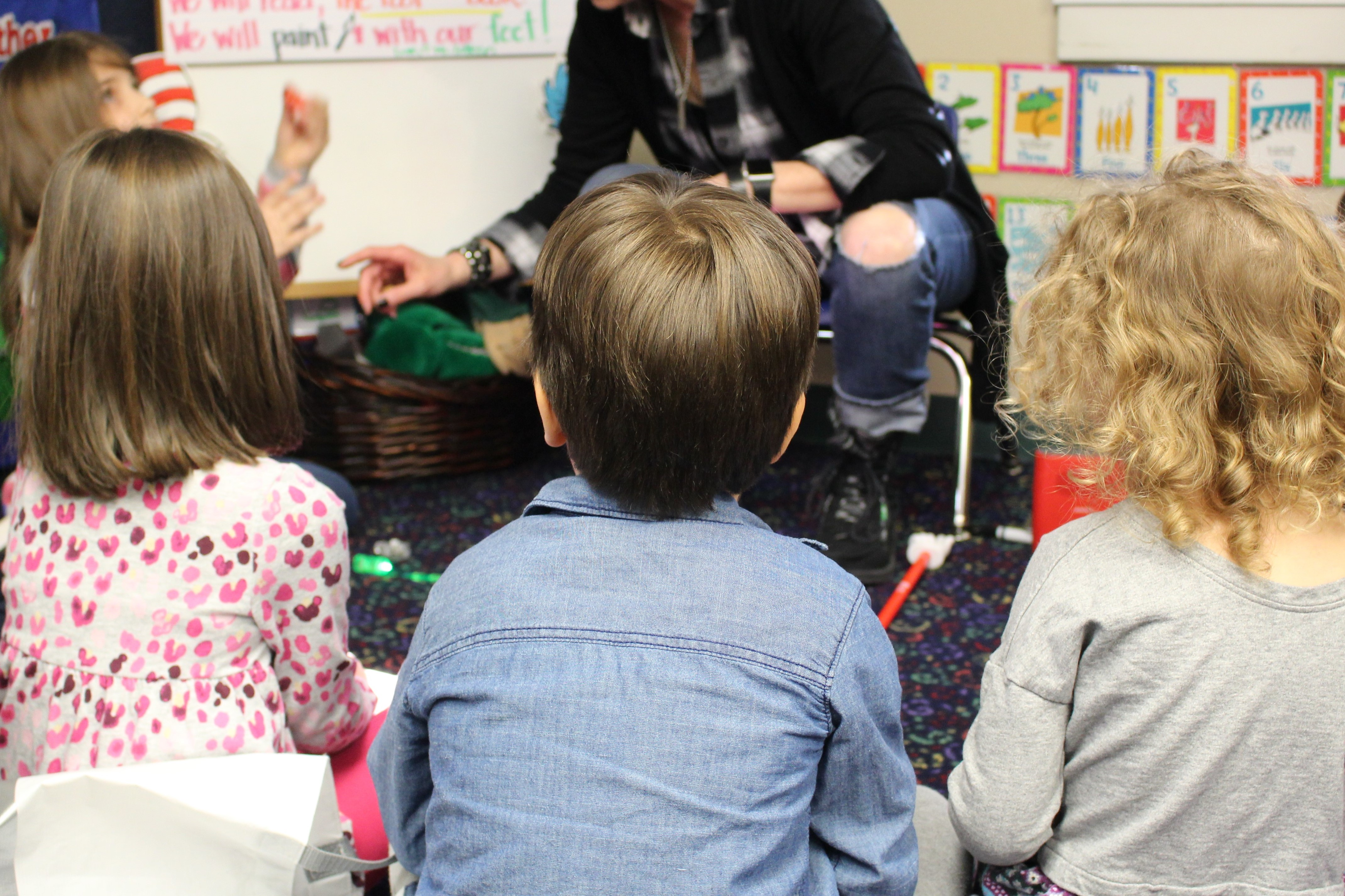 Pre-k student listening to stories