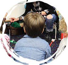 Pre-k student listening to story