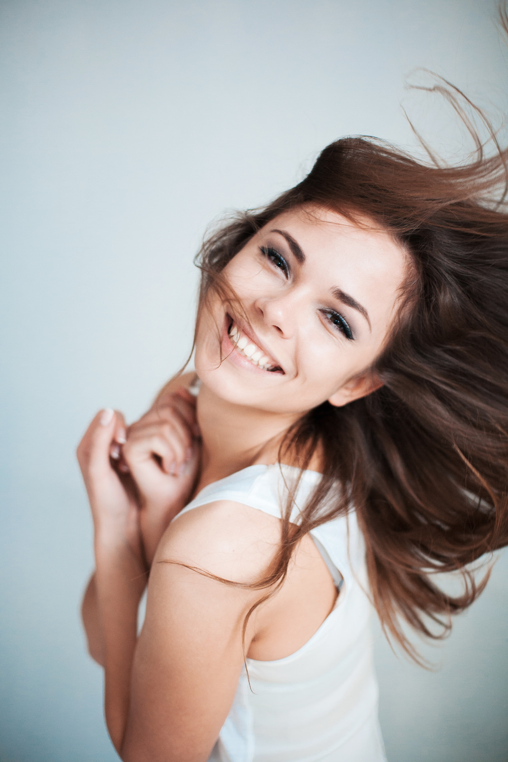 woman smiling while the wind blows back her hair
