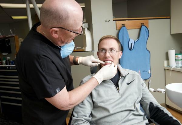 Wesley C. Wise DDS examining patient