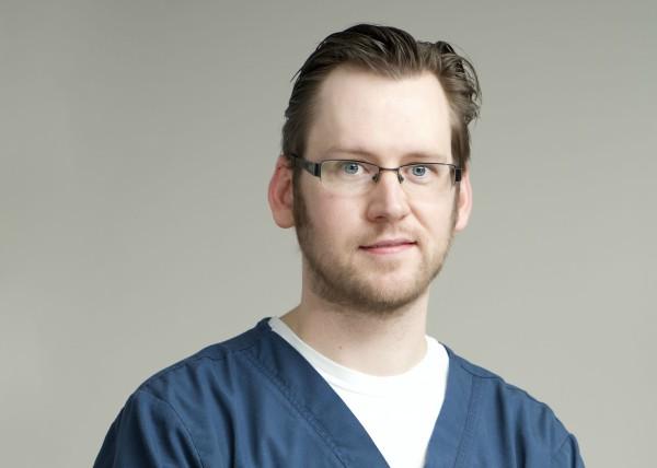 Headshot of Dr. William Madison