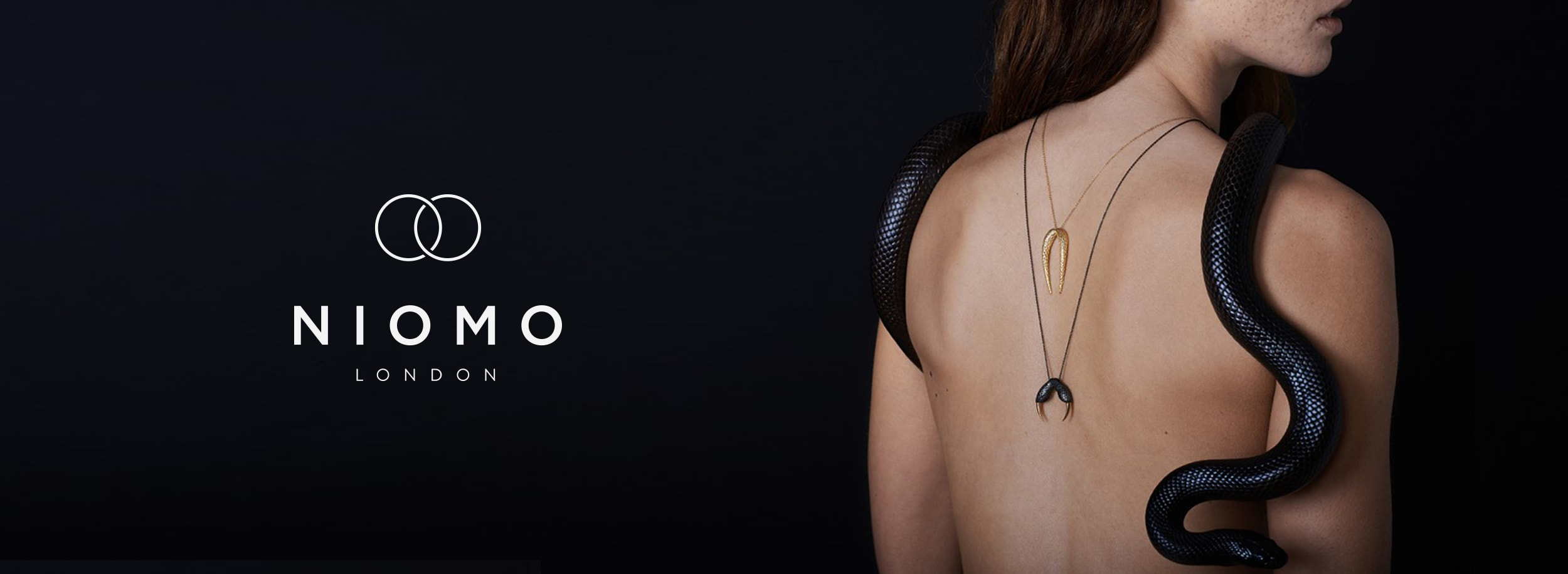 Calm and simple logo works great in contrast to NIOMO's necklaces and rings that are quite experimental and aggressive.