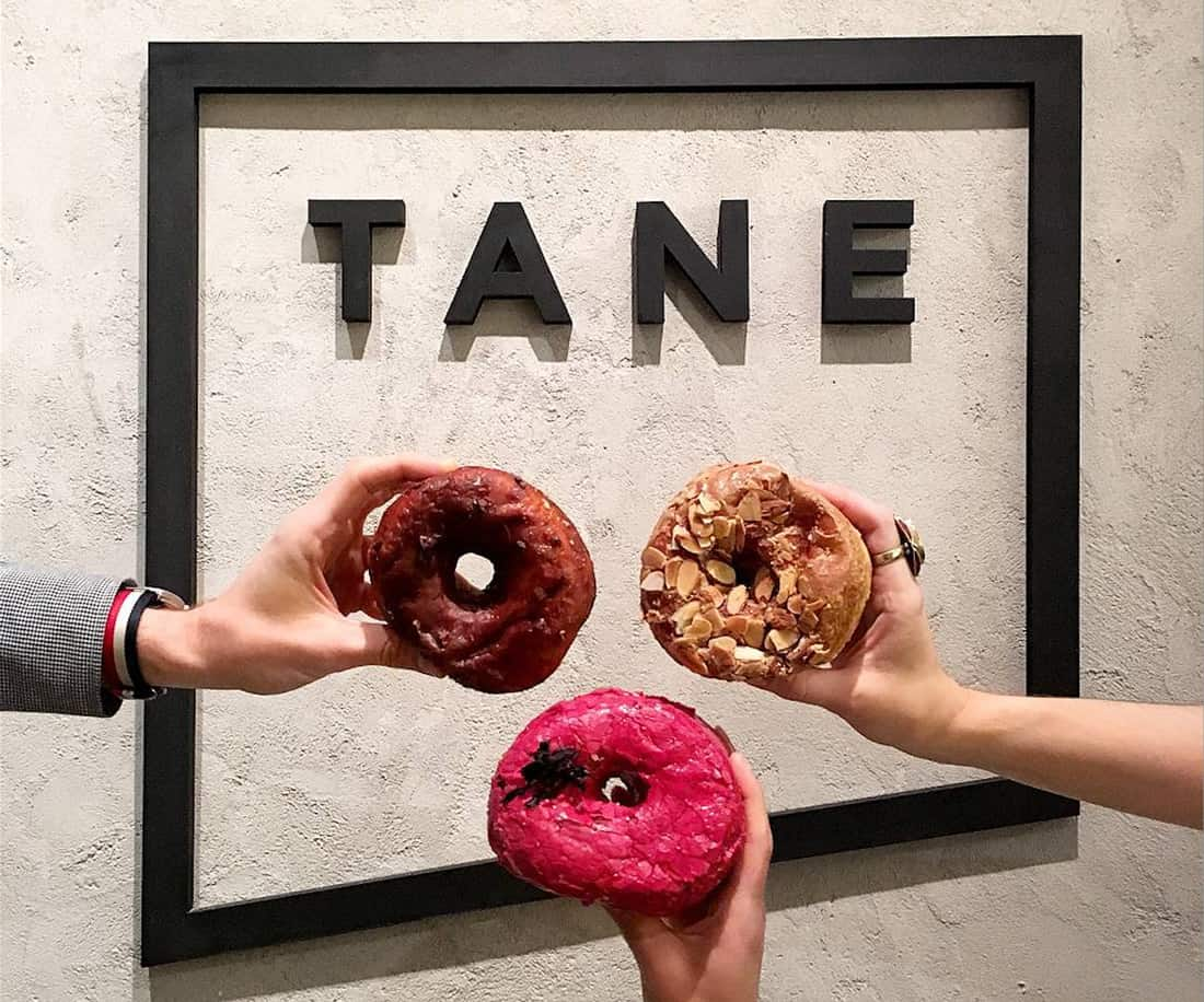 Tane Logo 3D office display with some doughnut treats